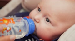 Beautiful baby drinking water from bottle Stock Footage