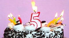 Birthday anniversary 5 years with cake and candles on pink background Stock Footage