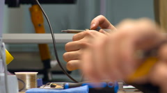 Soldering and Cutting Wires Close up Stock Footage