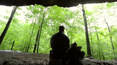 Wide Silhouette of Man Looking at Forest Stock Footage