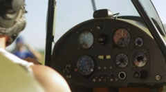 Boy in old airplane, tool panel Stock Footage