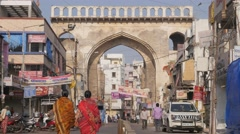 People walking through gate,Hyderabad,India Stock Footage