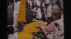 1962: indians make yellow garlands out of flowers BANGKOK, THAILAND Stock Footage
