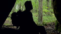 Silhouette of Male Hiker in Cave During Storm Stock Footage