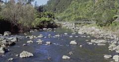 River and bridge in the Karangahake gorge, paeroa, new zealand Stock Footage