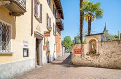 Narrow street in the Old Town of Ascona, Switzerland Stock Photos