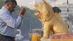 Man praying before  hindu temple on road with traffic,Hyderabad,India Stock Footage
