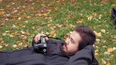 Photography shoot photographer laying on the ground Stock Footage