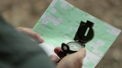Man Using Compass from Over Shoulder Stock Footage