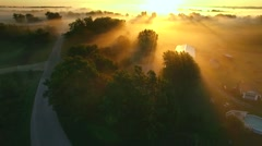 Breathtaking flight toward sunrise over foggy rural landscape Stock Footage