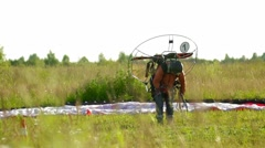 The glider pilot preparing for flight on a paraplane Stock Footage