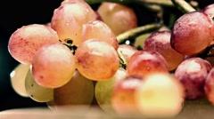 Mix color grape bunch, bleached colors. 4K closeup pan shot Stock Footage