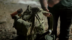 Man Puts on Backpack Stock Footage