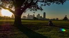 Dallas skyline sunrise time-lapse w/ nice shadow on grass & cow Stock Footage