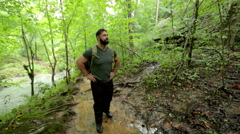 Man Hiking and Looking into Forest Stock Footage