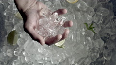 4k Shot of Cold Ice and Hand Grabbing Ice Cubes Stock Footage