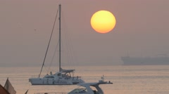 Sunrise with sailing yacht and container ship,Mumbai,India Arkistovideo