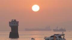 Sunrise over harbour with lighthouse,Mumbai,India Arkistovideo
