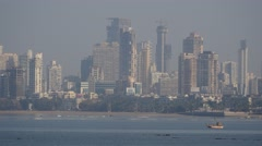Skyline along Back Bay with small fishermen boat,Mumbai,India Stock Footage