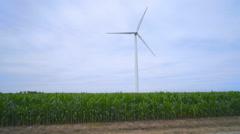 Wind power generator on green field. Green energy source Stock Footage