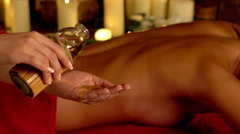 Young woman lying on wooden spa massage bed. Stock Footage