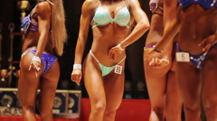Strong women in glamourous bikinis demonstrating perfect bodies, bodybuilding Stock Footage
