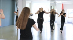 Group of female models in black are learning dance Stock Footage