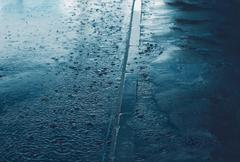 Rain, autumn day, weather concept - puddle and splashing water in rainy eveni Stock Photos