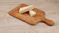 Two parmesan pieces Stock Footage