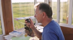 Air traffic controller talking to microphone Stock Footage