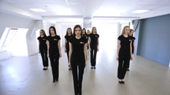 Young women are repeating dance movements in model school Stock Footage