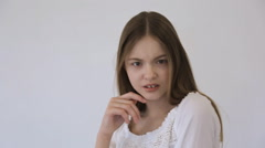 Pretty model with gap between front teeth poses in front of camera Stock Footage