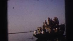 1962: a group of people on a large boat as they pass by people working  Stock Footage