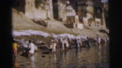 1962: laundry scene is seen with people washing clothes in a water body BANGKOK, Stock Footage