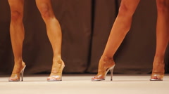 Sexy tanned ladies demonstrating bodies on stage at bodybuilding competition Stock Footage