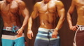 Sexy men with ripped muscles posing on stage at bodybuilding contest, sports Footage
