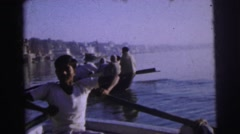 1962: men and women bathing and rowing a boat. BANGKOK, THAILAND Stock Footage