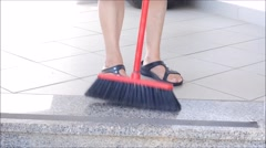 Lady sweeping the marble floor Stock Footage