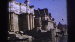 1962: a large and tall stone castle with spires and many windows by a lake  Stock Footage
