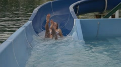 Great fun, laughing on water slide Stock Footage