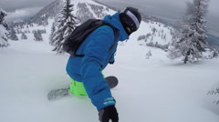SELFIE CLOSE UP: Snowboarder riding fresh powder and crashes down into snow Stock Footage