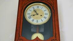 Wall clock with pendulum. Stock Footage