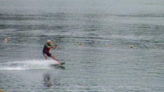 Jumping trampoline sport of water skiing. Stock Footage