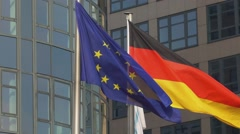 German and European Flag waving in the wind - slow motion shot EU Flag Stock Footage