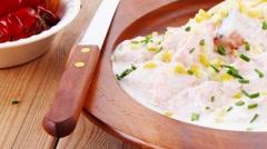 Wild salmon baked in cream cheese sauce with italian pasta on wood Stock Footage