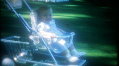 Dad takes the baby for a downhill ride in stroller-3589 vintage film home movie Stock Footage