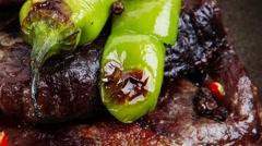 Roast beef fillet mignon on retro iron pan Stock Footage
