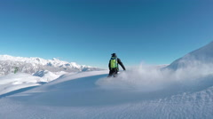 Happy snowboarder having fun riding powder snow backcountry in snowy mountains Stock Footage