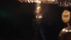 Scrubwoman sing on stage in vintage microphone under spotlight. Smoke. Scream Stock Footage
