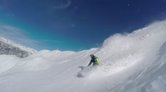 SLOW MOTION: Extreme freeride snowboarder doing powder turns in snowy mountains Stock Footage